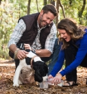 couple with dog in a park lifestyle photography